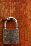 Padlock on a wooden door Royalty Free Stock Image
