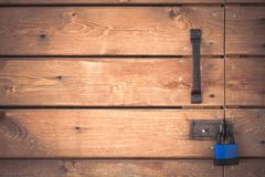 Padlock on a wooden door Cozy, home background royalty free stock image