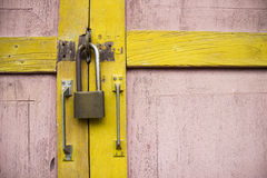 Padlock on wooden door Royalty Free Stock Photography