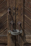 Padlock on a wooden door in a railway station in Italy. Old wooden door with padlock in a railway station stock photography