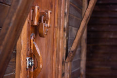 Padlock on the wooden door. Padlock wood weighs on a wooden door Royalty Free Stock Image