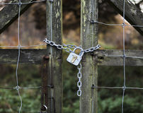 Padlock on wooden gate Royalty Free Stock Photos