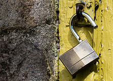 Padlock with yellow background stock photos