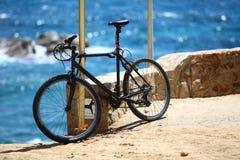 Padlocked bicycle Stock Images