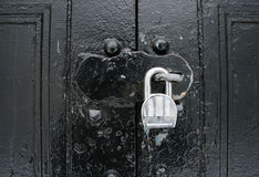 Padlocked black doors Royalty Free Stock Image