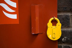 Padlocked bolt securing metal door Stock Photo