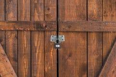Padlocked on brown wooden door Stock Image