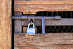 Padlocked door. Padlocked wood and metal door with heavy duty hasp Stock Image