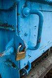 Padlocked door. Metal door locked with padlock Stock Photography