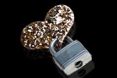 Padlocked heart. A heart secured with a padlock conceptual, love, celibacy etc Stock Photos