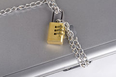 Padlocked laptop with chains Stock Photography
