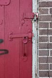 Padlocked red door Royalty Free Stock Photography