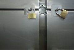 Padlocks. Closed fridge with padlock royalty free stock photo