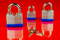 Padlocks. Isolated against a red background Royalty Free Stock Images
