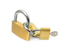 Padlocks. Brass and steel  padlocks joined together Royalty Free Stock Photos