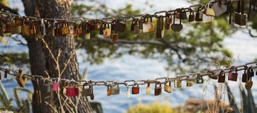 Padlocks as symbol of eternal love, valentine day hanging on chain stock image