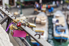 Padlocks on big pink padlock royalty free stock photography