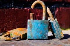 Padlocks. Blue padlock, rust padlock, family locks Stock Images