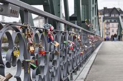 Padlocks on a bridge. Colored padlocks hung on the iron bridge or Eiserner Steg, as a token of love in Frankfurt Stock Photo