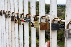 Padlocks on bridge railing. Love locks on the fence representing secure friendship and romance. The tradition of the newlyweds Royalty Free Stock Photo
