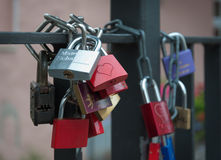 Padlocks chain fastened to the bridge. Royalty Free Stock Photo