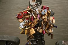 Padlocks fastened to each other on bridge of Paris royalty free stock photography