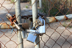 Padlocks on gate. Closed gate with padlocks on Royalty Free Stock Photography