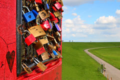 Padlocks on the grid. Of a lighthouse in Pilsum, Germany Royalty Free Stock Images