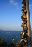 Padlocks of heart. A pole full of padlocks in front of sea, simbols of strong ties Stock Image