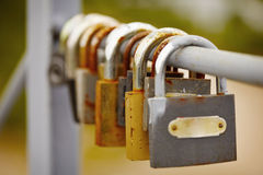 Padlocks left by bride and groom on bridge Stock Images