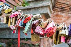 Padlocks left by lovers as a promise of love. Royalty Free Stock Images