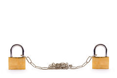 Padlocks linked with chains on white background Royalty Free Stock Photos