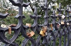 Padlocks locked luck on a metal fence Stock Image