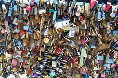Padlocks locked onto bridge over seine Royalty Free Stock Image