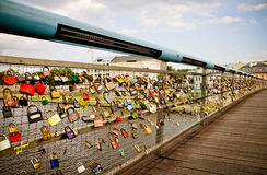 Padlocks of love footbridge. New love tradition. Couples lock their own padlock and throws the keys to the river Wisla. This is the spell for eternal love! Now Stock Image