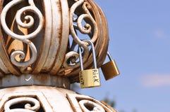 Padlocks with love lock. On old iron bridge stock images