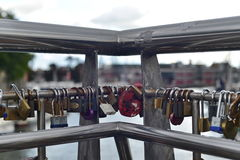 Padlocks or Love Locks Hang from a Bridge. Bristol, UK - October 10, 2016: Padlocks hang from a bridge in the town centre. Known as love locks the practice began Royalty Free Stock Photo