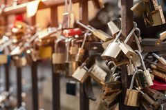 Padlocks love sign, romance and togetherness concept. Many love padlocks locked on rusty iron gate at Old Bridge, in Florence Stock Image