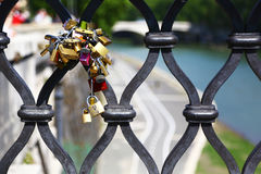 Padlocks of lovers on a bridge Rome Royalty Free Stock Image