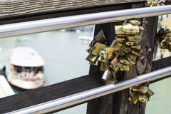 Padlocks of lovers placed on the bridge Stock Image
