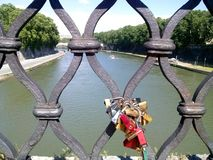 Padlocks mounted on Sant Angelo bridge of Tiber river, Rome, Italy. royalty free stock image
