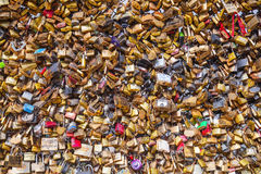 Padlocks with names hanging on railing of Pont des Arts in Pari Stock Photos