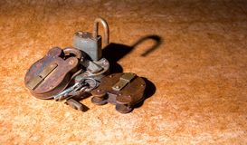 Padlocks. Pile of old rusty padlocks with some keys Stock Images