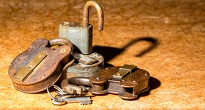 Padlocks. Pile of old rusty padlocks with some keys royalty free stock image