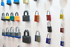 Padlocks on wall of store. Padlocks on the wall of the store Royalty Free Stock Image