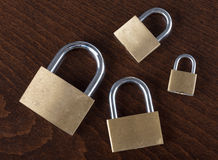 Padlocks. On a wooden background Stock Photos