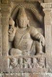 Padma Pani- Conch Holder. Bas relief image of Padma Pani (Conch Holder) at Virupaksha Temple in Pattadakal, District Bagalkot, Karnataka, India, Asia Royalty Free Stock Photo