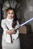 Padme Amidala with light saber. Cosplay princess Padme Amidala, armed light saber stock image