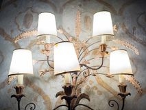 Vintage table lamp with five lampshades in a Venetian villa. Royalty Free Stock Images