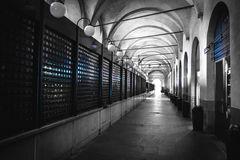 Padova piazza della frutta black and white arcade selective color blue light closed shops. Black and white arcade selective color blue light closed shops padova Stock Photos